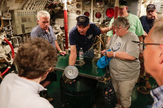 Submarine veteran Robin Onsoien shows people a ration can on a tour of the USS Cobia during SubFest Saturday, July 13, 2019, in Manitowoc, Wis. Joshua Clark/USA TODAY NETWORK-Wisconsin
