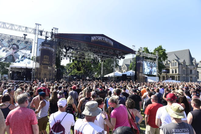 A large crowd gathers near the stage during the 2019 INKcarceration music festival.