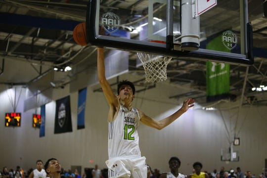 Class of 2021 five-star recruit Chet Holmgren blocks a shot during the Under Armour Association Finals tournament Friday in Emerson, Georgia.