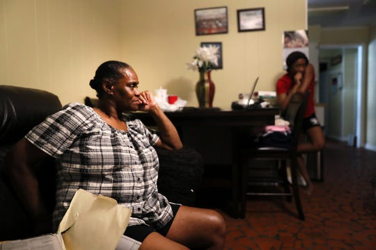 Dorothy Ross sits in the livingroom of her Frayser home with grandaughter Andrea, 16, in the background, on Saturday, July 13, 2019. MLGW purchased her previous home, one where she had lived with her family for more than 40 years. Though she says she had no interest in selling the property, she relented in 2017 gave up her house.