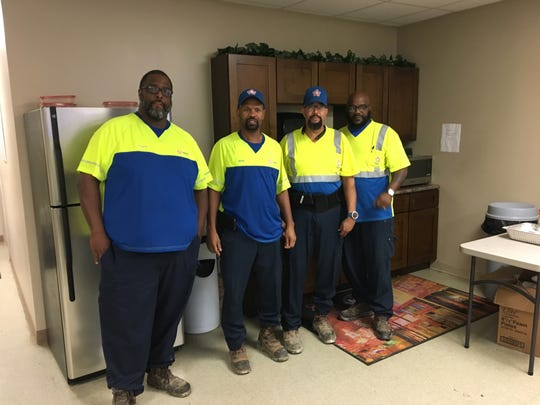 Sanitation truck driver Kevin Clark, second from right, has joined with fellow Republic Services employees from Memphis and nearby Millington, Tenn., in filing a discrimination complaint against their employer, the second-largest waste management company in the US, according to NASDAQ figures.