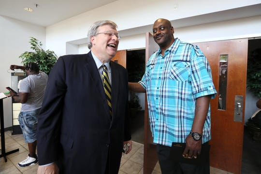 William Bedford chats with Mayor Jim Strickland after his graduation from Manhood University on July 13.
