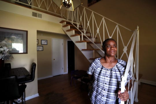Dorothy Ross stands in the entryway of her Frayser home on Saturday, July 13, 2019. MLGW purchased her previous home, one where she had lived with family for more than 40 years. Though she says she had no interest in selling the property, she relented in 2017 gave up her house.