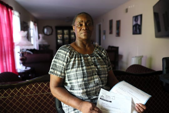 Dorothy Ross holds a letter of intent to purchase her house by MLGW, though she says she had no interest in selling the place she had called home for over 40 years. In 2017, she relented and gave up her property to the company. Ross is seen here in her new Frayser home on Saturday, July 13, 2019.