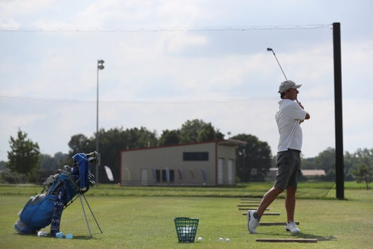 Mark Smith tees off from the driving range at Vantage Point Golf Center in Cordova on Friday, July 12, 2019.