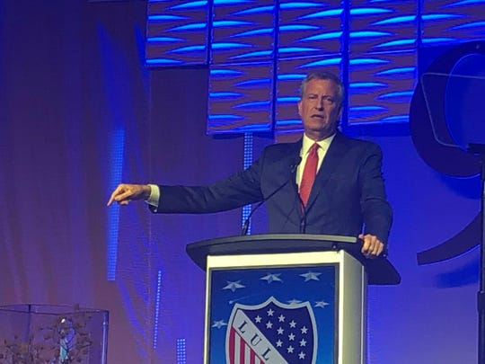 Presidential candidate and New York City Mayor Bill de Blasio speaks Friday night at the LULAC national convention banquet.