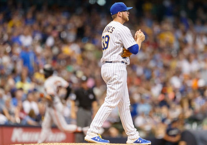 Brewers pitcher Corbin Burnes gives up a two-run home run to Evan Longoria in the sixth inning.