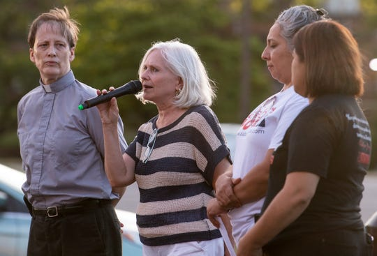 Interpreter Iris Moebius interprets during a local protest of the conditions faced by migrants, as part of the worldwide Lights for Liberty: A Vigil to End Human Concentration Camps event, at the Unitarian Universalist Fellowship in Montgomery, Ala., on Friday July 12, 2019,