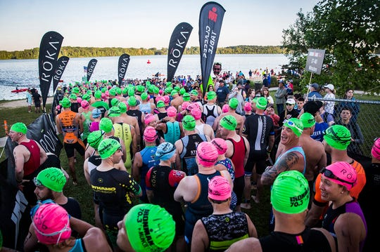 Hundreds of athletes from around the U.S. competed in the 2019 Muncie Ironman 70.3 at Prairie Creek Reservoir Saturday, July 13, 2019. The race is divided into a 1.2-mile swim, 56-mile bike ride and 13.1-mile run.