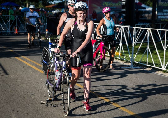 Lucy Martin transitions to the bike portion of the 2019 Muncie Ironman 70.3 at Prairie Creek Reservoir Saturday, July 13, 2019. The race is divided into a 1.2-mile swim, 56-mile bike ride and 13.1-mile run.