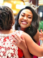 Miss Tennessee 2019 Brianna Mason catches up with Hobgood Elementary counselor Jimmie Strickland during an autograph signing at Stones River Town Centre on July 13.