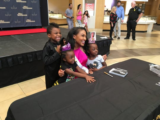 Miss Tennessee Brianna Mason poses with fans, from left, Logan, Gwen and Maddie Fain. Their mother, Ebony Fain, brought them to Stones River Town Centre Saturday to meet the newly crowned honoree.