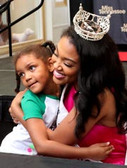 Krie Mosby, 5, gets a hug from Miss Tennessee 2019 Brianna Mason during an autograph signing event at the Stones River Town Center Main Stage on Saturday, July 13, 2019.