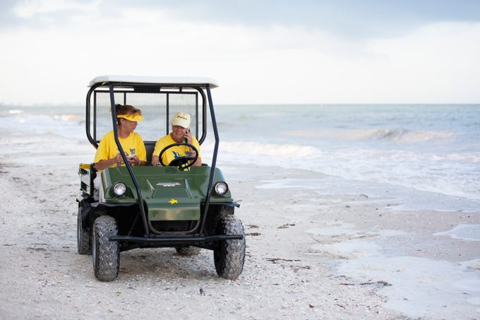 Rae Ann Hanley, left, and Lynne Crews, volunteer sea turtle monitors, are on their way for excavating turtle nests on Thursday, July 11, 2019, on Bonita Beach in Bonita Springs. Volunteers count empty egg shells, hatchlings left in the nest and unhatched eggs to determine the total number of eggs laid.