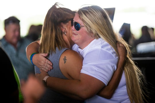 Brooke Singletary, right, hugs friends and family as they line up to give their condolences during a celebration of life for her brother, Colby Singletary, at the Collier County Fairgrounds on Saturday. Singletary, a star wrestler and football player at Palmetto Ridge High School, died in a car crash on July 6.