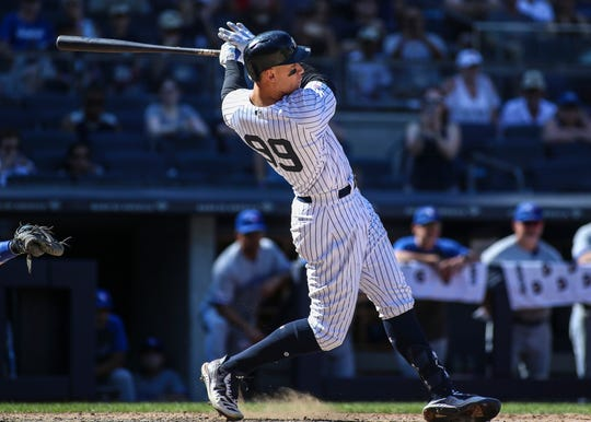 Jul 13, 2019; Bronx, NY, USA; New York Yankees right fielder Aaron Judge (99) hits an RBI single against the Toronto Blue Jays in the ninth inning at Yankee Stadium.