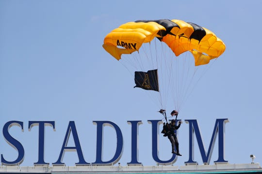 A member of the United States Army Golden Knights, parachutes into Yankee Stadium before a game between the New York Yankees and the Toronto Blue Jays Saturday, July 13, 2019, in New York.