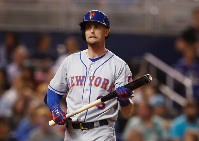 New York Mets' Jeff McNeil reacts to a strike thrown by Miami Marlins starting pitcher Caleb Smith during the third inning of a baseball game Friday, July 12, 2019, in Miami.