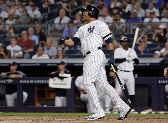 New York Yankees' Edwin Encarnacion follows through on a three-run double during the fifth inning of a game against the Toronto Blue Jays, Friday, July 12, 2019, in New York.