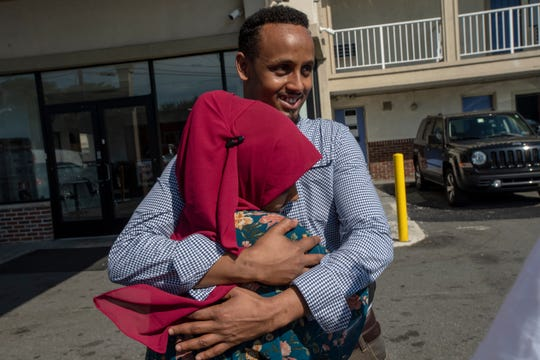 Abdikadir Mohamed, a Somali man who had a visa to join his wife and child in the U.S., was freed after 20 months in detention at the Elizabeth Detention Center. Abdikadir's wife Malyuun drove from Ohio to reunite with him at a Motel 6 in Elizabeth on Saturday, July 13, 2019. Abdikadir never made it past the airport, where his visa was stamped for entry but he was stopped by a roving Customs and Border Protection officer who pulled him aside for questioning about his background. The interview was marred by lack of translation and misunderstanding, say lawyers.