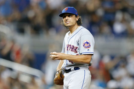Jason Vargas of the New York Mets reacts after giving up a 2-run home run in the third inning against the Miami Marlins at Marlins Park on July 12, 2019 in Miami, Florida.