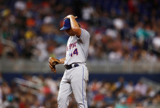 New York Mets starting pitcher Jason Vargas (44) reacts after giving up two home runs during the third inning of the team's game against the Miami Marlins on Friday, July 12, 2019, in Miami.