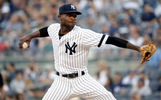 New York Yankees' Domingo German delivers a pitch during the first inning of a baseball game against the Toronto Blue Jays, Friday, July 12, 2019, in New York.