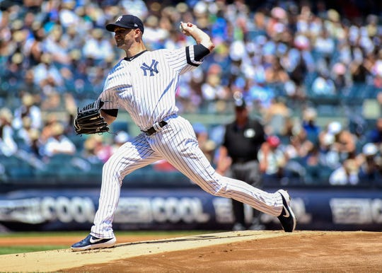 Jul 13, 2019; Bronx, NY, USA; New York Yankees pitcher J.A. Happ (34) pitches against the Toronto Blue Jays in the first inning at Yankee Stadium.