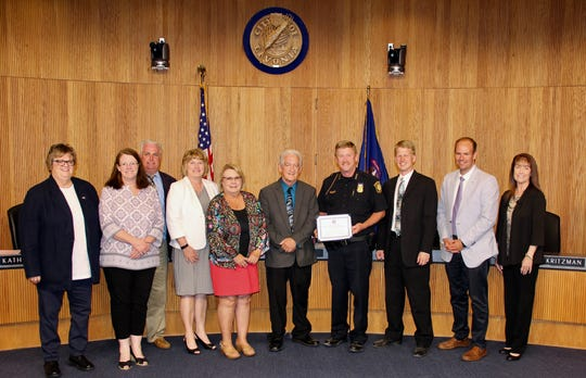 Livonia Mayor Dennis Wright and City Council members recently honored Police Chief Curtis Caid for his 40 years of service with the city.