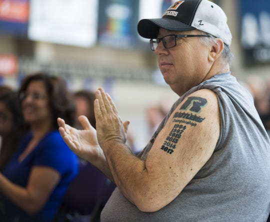 Michael McCarville displays his championship tattoos on his arm during a press conference at Talking Stick Resort Arena in Phoenix, Ariz. July 12, 2017.