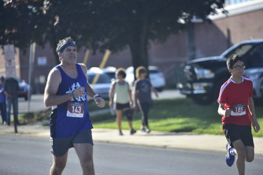 Brian Mount (left) participates in the 16th annual Tim and Susan Cook Memorial Race in Chambersburg in July 2019.