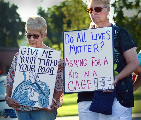 Protesters held signs during Friday's mass mobilization against the Trump administration's human detention camps by participating in Lights for Liberty at York County's ICE Detention Center at York County Prison. (Bil Bowden photo)