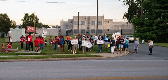 In this file photo from July 12, 2019, protesters stand in front of York County Prison as part of a national candlelight vigil against immigration detention.