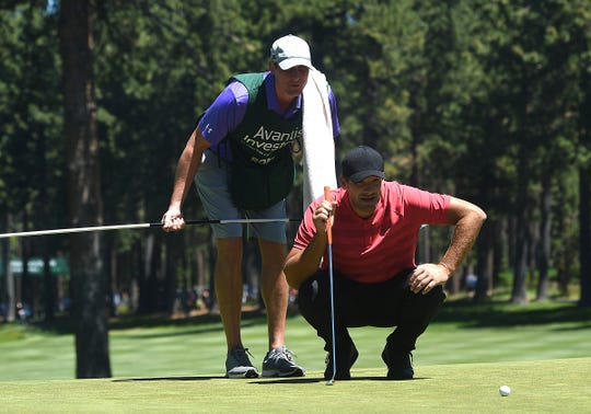 Tony Romo lines up a putt on the 8th green during the 2019 American Century Championship at the Edgewood Tahoe Golf Course on July 13, 2019.