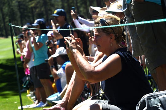 Fans line the 9th fairway during the  American Century Championship at the Edgewood Tahoe Golf Course on Saturday.