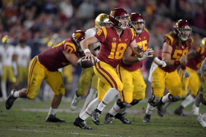 USC quarterback J.T. Daniels (18) scrambles against Notre Dame last season at Los Angeles Memorial Coliseum.
