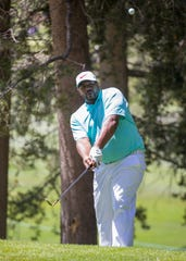 Jerome Bettis chips onto the green during the American Century Championship at Edgewood Tahoe Golf Course on Nevada.