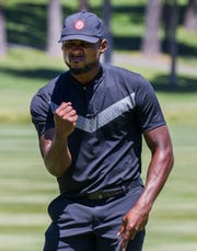 Patrick Peterson reacts after sinking a putt during the American Century Championship at Edgewood Tahoe Golf Course in Stateline on Friday.