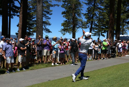 Justin Timberlake hits an approach shot on the 9th hole during the 2019 American Century Championship at the Edgewood Tahoe Golf Course on July 13, 2019.