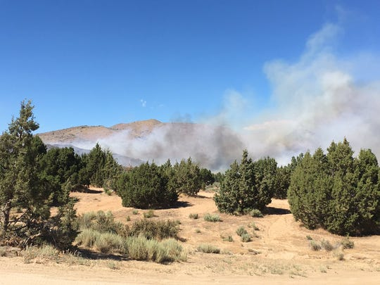 Smoke is seen blowing from the 50-acre Jasper Fire in Sun Valley.