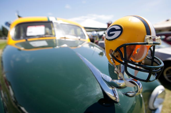 A miniature Green Bay Packers helmet is strapped to the hood ornament of a 1950 Packard on Saturday, July 13, 2019, at the Iola Car Show and Swap Meet in Iola, Wis. Tork Mason/USA TODAY NETWORK-Wisconsin