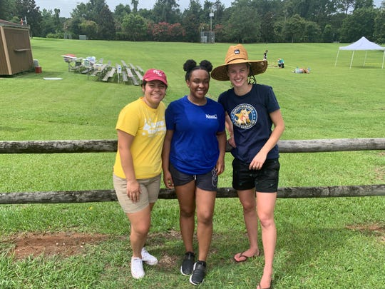 Volunteers from the Challenger IMAX Center, Nanichi Hidalgo, Hidi Solomon and Nika Blank at the Tally Rocket Faire at Apalachee Regional Park on Saturday.