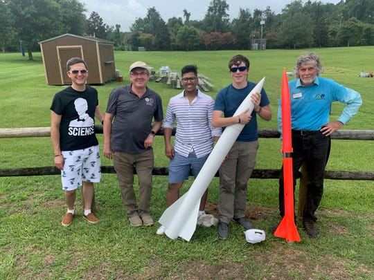 William McCluskey,  founder and CEO of Proper Channel, FAMU-FSU Dean of Engineering Murray Gibson, event organizers Jawad Khan and Atilla Sulker and Jimmy Yawn, a University of Florida National Association of Rocketry mentor, stand with their rockets at Tally Rocket Faire at Apalachee Regional Park on Saturday.