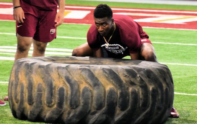 FSU quarterback James Blackman flips a tire at the Seminoles' Lift for Life event.