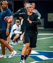 Chiles senior quarterback Garrett Greene works out during the Elite 11 quarterback competition in Dallas.