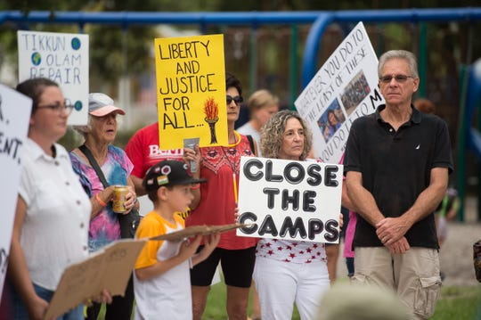 People gather at Kiwanis Park to march in downtown Stuart during Lights for Liberty: A Vigil to End Human Concentration Camps, in solidarity with similar efforts nationwide Friday, July 12, 2019, to protest the inhumane conditions faced by migrants, according to www.lightsforliberty.org.
