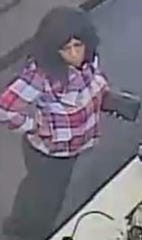 A woman who appears on surveillance video is sought by Port St. Lucie police on suspicion of credit card theft