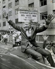 In this Aug. 16, 1969, file photo, Apollo 11 astronaut Buzz Aldrin waves from a convertible during a parade in Houston. Aldrin had a long list of accomplishments by the time NASA chose him for the third astronaut group in 1963: third in his class at West Point, fighter pilot in Korea, Air Force officer, a doctorate in astronautics. He was dubbed Dr. Rendezvous for his expertise in orbital dockings.