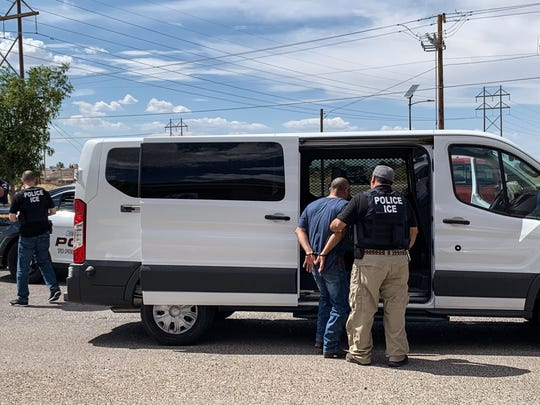 A middle-aged man was handcuffed by U.S. Immigration and Customs Enforcement officers Saturday, July 13, 2019, at the Quail Park shopping center at 12770 Edgemere Blvd. An El Paso Police Department unit was on the scene during the arrest.