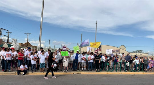 Protesters gather at the Santa Fe Bridge in South El Paso on Friday, July 12, 2019, to call for the end of migrant detention. They marched up El Paso Street toward Cleveland Square Park. Lights for Liberty organized the protest as part of a widespread collaboration.
